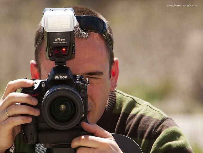 Fotógrafo fotografiando